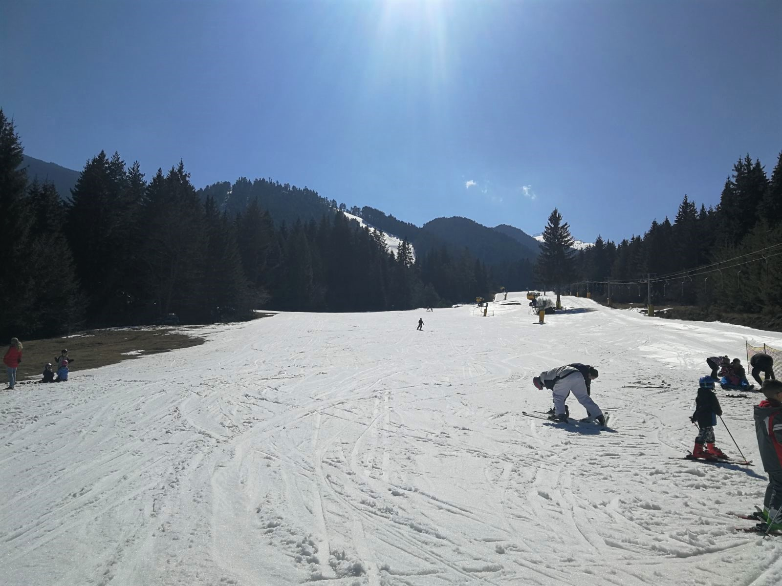 Snow spots covered with artificial snow
