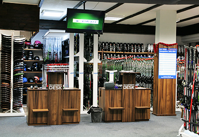 The check in desks and the equipment collection area of the ski rental shop