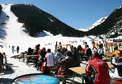 The restaurants around the upper Gondola lift station with a vew towards the black Tomba ski run.