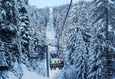 Yastrebetz Express chairlift bringing skiers up to the slopes above Borovets